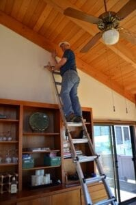 Owner painting high wall in sea ranch abalone bay