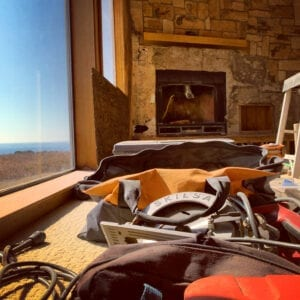 still life of construction tools in front of fireplace and picture window showing the ocean