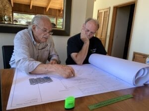 Architect Obie Bowman and contractor John Seed review renovation house plans