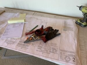 Still life of architect plans, sea ranch abalone bay, remodel, renovation,