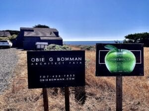 Signs for Obie Bowman and Apple Construction in front of Abalone Bay, renovation signs