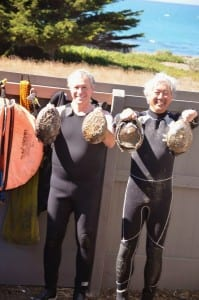 two divers with abalone