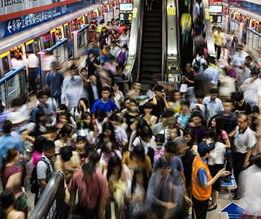 commuters in metro station during rush hour,