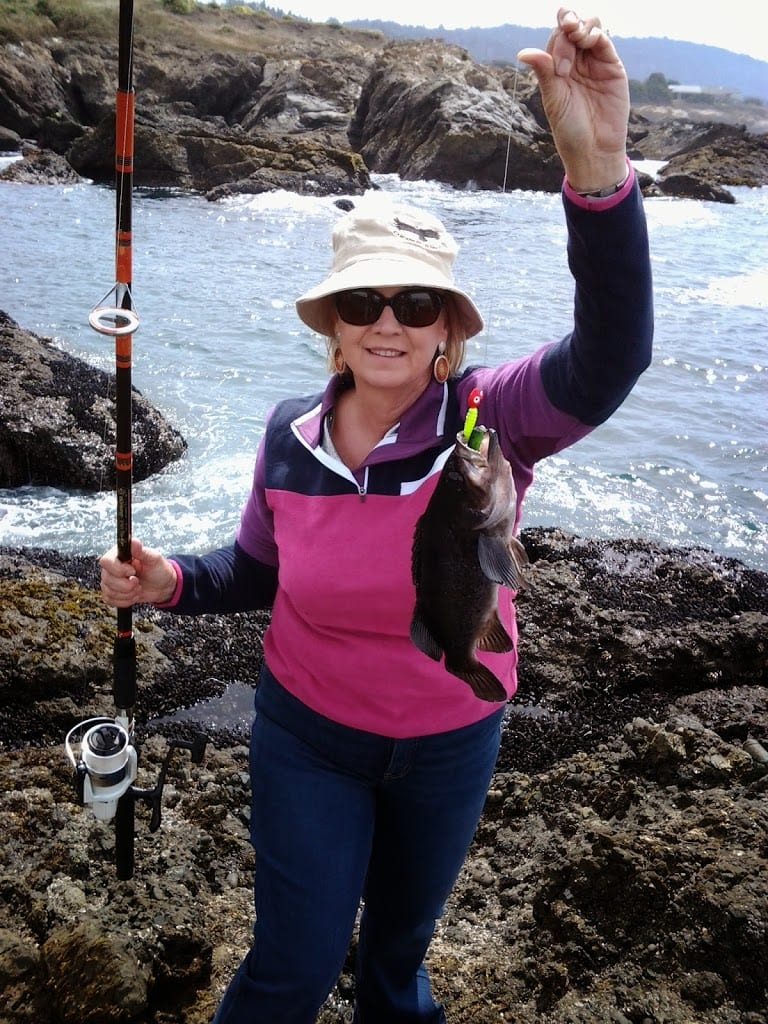 owner with rock cod on fishing pole