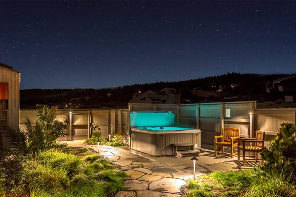 Hot tub in the courtyard night sky