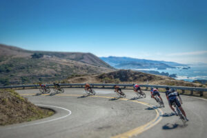 bike racers downhill on shoreline highway 1