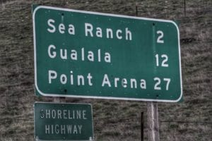 Highway sign showing miles to Sea Ranch