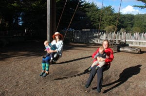 parents and children swinging at one eyed jacks playground
