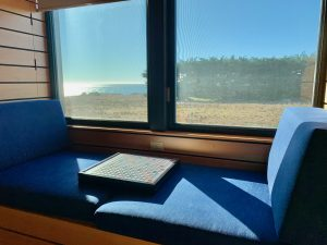 window bench with scrabble board and bench seating, ocean views