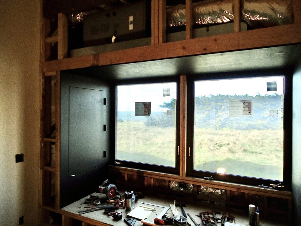 Window above bench in game room prior to facing