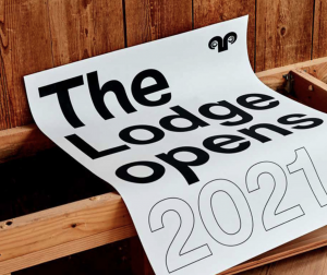 """sign draped on bar """"The lodge opens 201"""""""