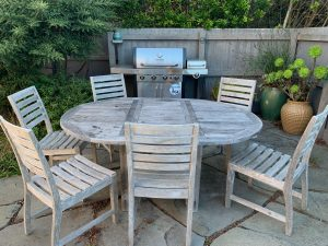 Courtyard teak picnic table, 6 chairs and barbecuehairs